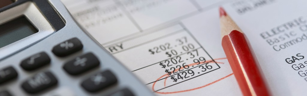 Calculator and Pencil with Invoice --- Image by © Fancy/Veer/Corbis